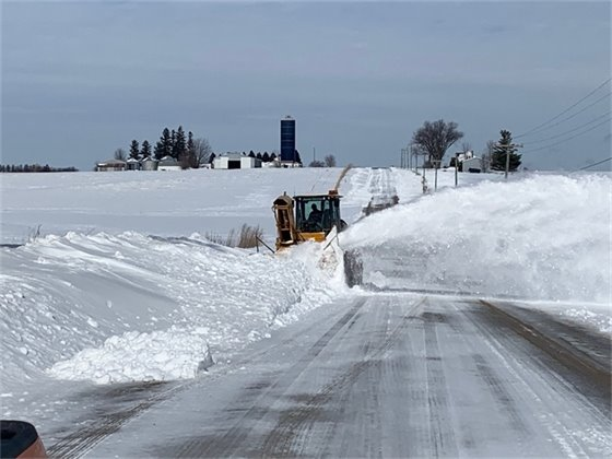 Snow Blower clearing a secondary road in Linn County