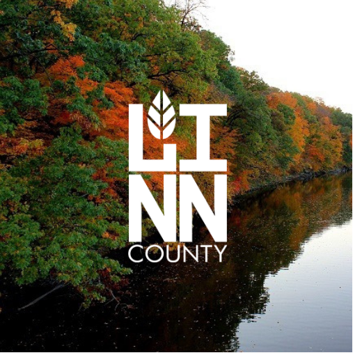 Trees along river with Linn County logo