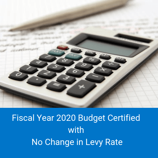 Calculator and pen with text Fiscal Year 2020 Budget Certified With No Change in Levy Rate