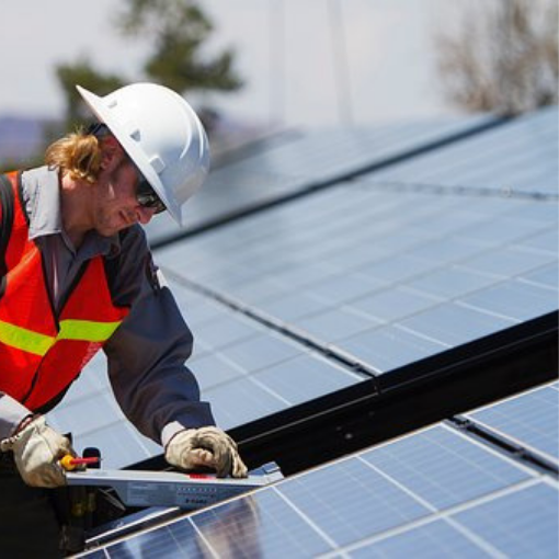 Person installing solar energy panels