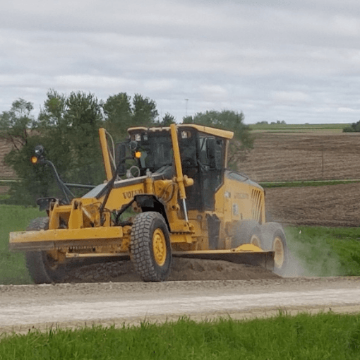 Motor grader on a gravel road