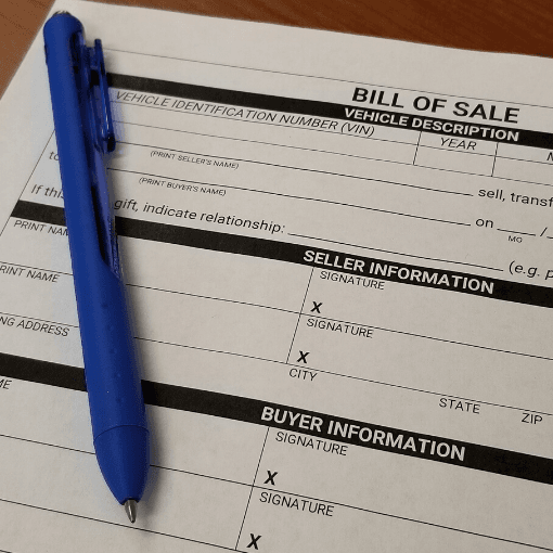 Bill of Sale form with a pen