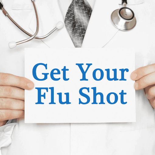 Doctor holding sign saying Get Your Flu Shot