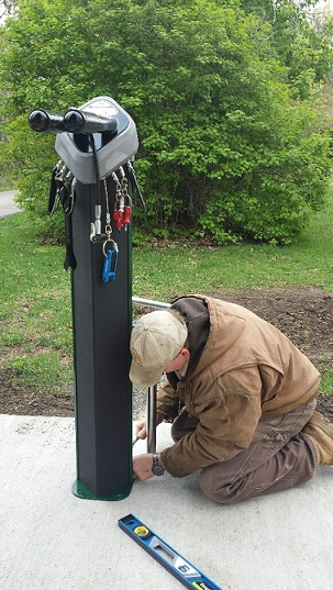 Conservation staff installing bike repair station